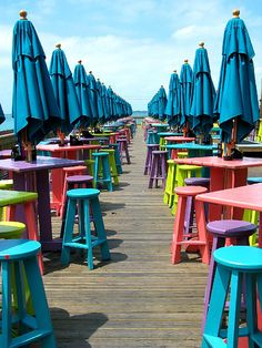 Key West, Florida - colorful umbrellas & tables line a boardwalk. Key West is at the southern most tip of the U.S. with gorgeous sunsets over the Gulf of Mexico. Eaten here many times