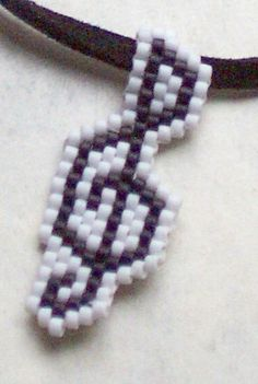 Treble Clef Necklace by ambrosianbeads, via Flickr