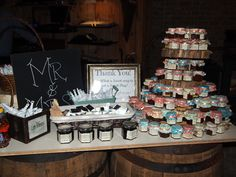 Some of our adorable mason jar wedding favors, on display at a sweet wedding this past weekend! Filled with homemade butters and jams to complete a biscuit bar! They're just too precious!
