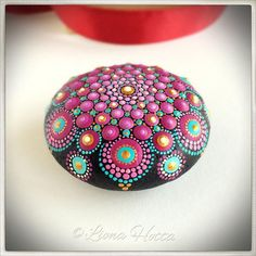 This is a violet, turquoise and gold stone Mandala with glow in the dark detail. I have enjoyed so much creating it and happy to put it out there for you to fall in love with it too. It is approx. 5.25 cm. diameter and it is sealed with matt varnish. It is suitable for indoors use.