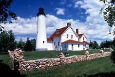 Point Iroquois Lighthouse - Brimley. This lighthouse was first illuminated in 1857. At one time, the entrance to the St. Mary's River and the Soo Locks was one of the busiest shipping lanes in the country.