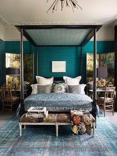 Color ... In the master bedroom, a Louis XVI-style bench upholstered in a Pierre Frey fabric sits at the foot of the four-poster bed