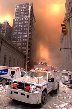 ~ A New York City Police Emergency Services truck drives away from 1 World Trade Center with the city burning in the distance.as the World Trade Center's South Tower burns uncontrollably, on September 11 September 2001, Remembering September 11th, World Trade Center Attack, Trade Centre, We Will Never Forget, Lest We Forget, Flatiron Building, Nuclear Winter, Historia Universal