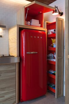 Love the really functional small-kitchen storage, and of course the red Smeg fridge! :)