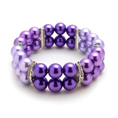 Let this versatile stretch bracelet adorn your look for a dressy night out on the town or out and about. The bracelet features Tri-Colored Purple glass pearl beads and crystal rhinestones filaments.