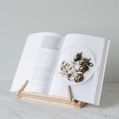 Keep your recipe books upright and away from spills with this adjustable wooden book stand. Folds flat for storage alongside your collection of cookbooks. 13.5″ L x 10″ H x 9.5″ W Material: Oiled beech wood Made in Germany