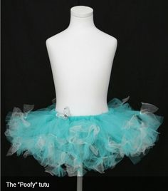 48ddbcfeeb Soft turquoise poofy tutu, with accents of white and silver glitter tulle.  Pretty Missy