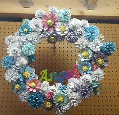 Hand painted Pinecone wreaths.  Grapevine  Various Sizes If you would like special characters or added characters or wording that will be extra cost. You can co