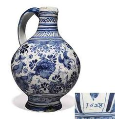 A LONDON DELFT DATED BLUE AND WHITE CHINOISERIE WINE-BOTTLE  1628, SOUTHWARK, PICKLEHERRING QUAY  Of conventional form, painted with a frieze of 'bird-on-rock' amongst flowering plants and insects, the neck with banded dot and dash ornament, the lower part with a band of trellis pattern, dated 1628 below the handle  7 5/8 in. (19.3 cm.) high