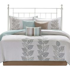 Features:  -Set includes 1 coverlet, 2 shams and 3 pillows.  -Construction Material: Polyester.  -Cleaning & Care: Machine wash and tumble dry. .  -Coverlet underside is a different color from the fro