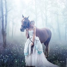 But in mine I would not be wearing that ridiculous blue dress and the photographer would know to take the picture until the horse was not chewing and looking bored.