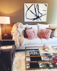 Instagram media by jessi_afshin - Home sweet home looks something like this... My coffee table is 50% off and my fuzzy pink pillows are on sale (these babes are rarely marked down!)    so happy to be home with my Chloe girl , you can shop my living room details via this link:: http://liketk.it/2r7Vy or the @liketoknow.it app! Xo #liketkit