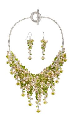 A Peridot Garden Party! Sparkling Celestial Crystal bicones surrounding glass pearl filled flowers  #jewelrymaking #beading #diyjewelry #jewelrydesign