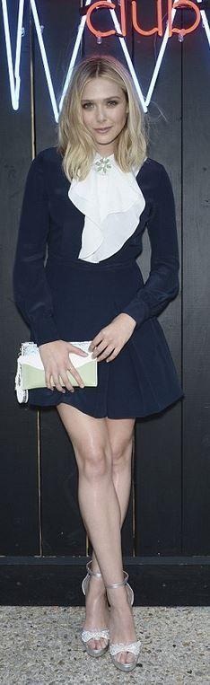 Who made Elizabeth Olsen's blue dress and clutch handbag?