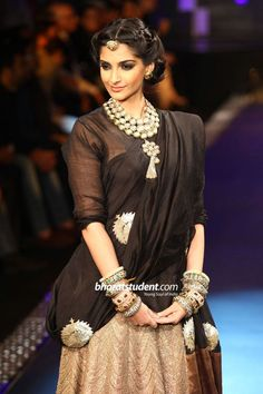 Sonam Kapoor for pc jewellers. kundan jewellery and those big kadas