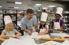 """Professor Doug Fee with summer campers in """"Kids in the Kitchen."""""""