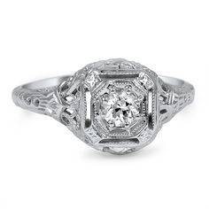 The Juin Ring - This Edwardian-era ring features an old European cut diamond secured within an octagonal setting and gracefully lofted above an intricate gallery that is adorned with hand-engraved and pierced details.