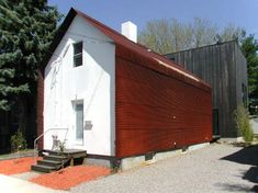 tin roof -rusted...one of the more inventive uses of cor-ten...  Could be a cute barn house!