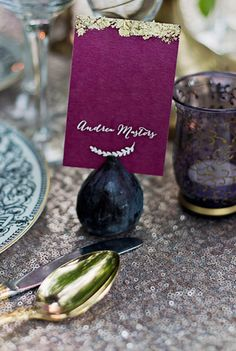 The gold leaf on the place name card is so elegant...love the sequinned table cloth too!