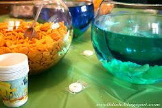 under the sea decor. fishbowl full of goldfish! Tia this would be a cute idea for Georgie's party!