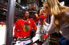 Patrick Sharp says hello to his wife Abby and daughter Madelyn during a pause in pregame warmups. #Swoon