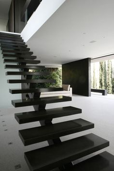 Floating staircase with stringer in middle - want in white!