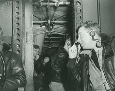A pilot of the U.S. Navy Airship Squadron 24 checking his inter-com, written below the image, 'Testing...One...Two...Three... Command pilot checks inter-com with radioman'.