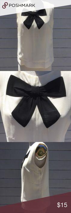 Forever 21 Trompe l'oeil Bow Top Prim cream top with black trompe l'oeil bow by Forever 21. Back zipper. Size medium. Forever 21 Tops