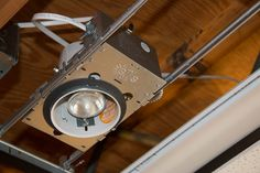 Installing panel enclosure on recessed lighting housing Drop Ceiling Basement, Drop Ceiling Lighting, Ceiling Lights, Dropped Ceiling, Ceiling Tiles, Light Installation, Diy, Ceiling Lighting, Bricolage