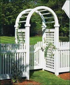 Spindle Top Lattice Arbor - Low maintenance and a keen eye for style are displayed proudly in this combination of solid cellular vinyl arbor, lattice panels, gate, and fence. The Spindle Top arbor houses a curved rail walk gate which in turn is the perfect partner for a handsome Freeport Chestnut Hill fence.