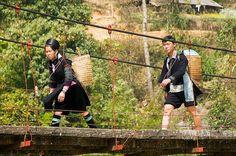 Black Hmong couple and their baskets walking near Sapa Vietnam   Flickr - Photo Sharing!