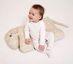 Floppeze nursing pillows moves with your baby from nursing to sitting up to keeping them safe on the couch while they snooze.