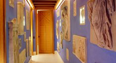 Hall of fame! Interior doors are as important as exterior ones. Sculptures amp up the roman vibe.  Wall of exotic!  by John Stefanidis