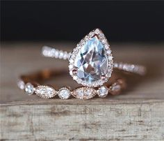 Check this morganite unique engagement ring set from Camellia Jewelry. Scrupulously handmade in fine detail, it is a unique two tone gold ring set that will show her how much you care without breaking the bank. The engagement ring features an half eternit Engagement Ring Settings, Vintage Engagement Rings, Diamond Engagement Rings, Pear Engagement Rings, Morganite Engagement, Engagement Timeline, Engagement Quotes, Engagement Decorations, Engagement Cards