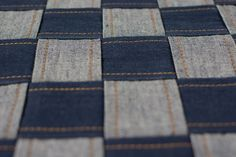 Close-up of Eco-friendly Chess Board Cushion Cover  This cushion cover is made from eco-friendly handloom denim, and is completely hand-stitched on a foot pedal operated vintage sewing machine, by a seasoned tailor.  The chess-board design, made by interlacing strips of denim fabric, is an ever-green design, and has a mesmerizing effect.  Specially Crafted for the Denim Lovers, Who Care!!! Unique hand-made products, not available anywhere else. PC : @anniebakshi_photography…