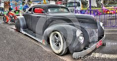 1939 Custom designed black Ford Coupe with pin striping and suicide doors on display at car show in Melbourne, Australia