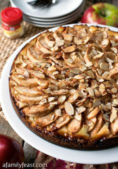 Fresh Apple Torte - A fantastic dessert with a sweet shortbread crust, vanilla and cream cheese filling and slices apples and almonds on top!