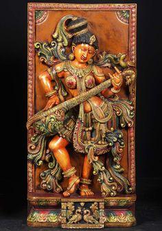 A pleasing wooden art work of Goddess Saraswati