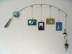 A fishing rod #upcycled into a picture frame holder: