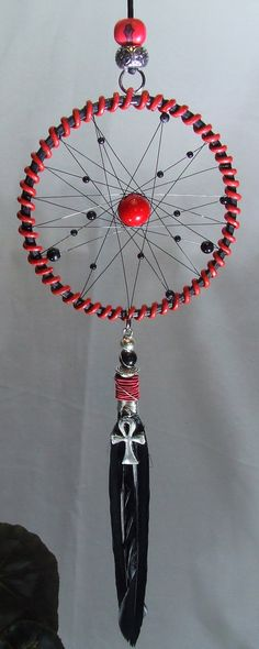 Check out this item in my Etsy shop https://www.etsy.com/uk/listing/260140080/red-black-dream-catcher-wall-hanging