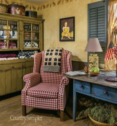 """It's """"Rhapsody in Blue"""" for this Ohio homeowner who decorates her abode with her favorite hue, primitive antiques and decorating painting. (Photography by Bill Mathews and styling by Janie Ackerman.)"""