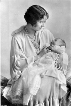 """Elizabeth Bowes-Lyon cradles her daughter, Princess Elizabeth. """"I know Elizabeth wanted a daughter,"""" said delighted dad Prince Albert (known as Bertie), who would become King George VI when his older brother abdicated. Reine Victoria, Queen Victoria, George Vi, Queen Mother, Queen Mary, Prinz Philip, Lady Elizabeth, Duchess Of York, Isabel Ii"""