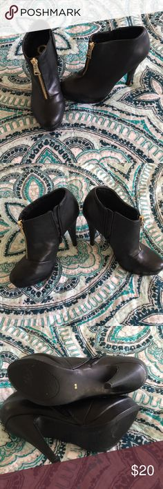 Guess booties Never worn but had them stored in my closet. One has a nick in it as pictured. Guess Shoes Ankle Boots & Booties