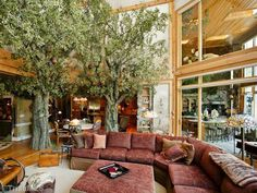 Have you ever seen trees growing from the floor in a living room? If not, now you have! Love the way the trees are incorporated into this Greensboro, NC living room design. Amazing! #homes