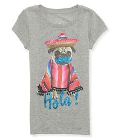 """Toss on our Hola Pug Graphic T then hit up your favorite Tex-Mex restaurant and <i>woof</i> down some tasty eats! The adorbs top features a cuddly pug wearing a sombrero and a glittery mustache, while sparkly Hola! text dazzles below.<br><br>Tag free label.<br>Relaxed fit. Approx. length (10): 22""""<br>Style: 5578. Imported.<br><br>100% cotton.<br>Machine wash/dry."""