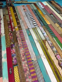 "A Fabulous Pallet Wall ow'd they do it? Brooke said, ""We painted and stained some, decoupaged with tissue paper, scrap book paper, napkins, fabric, magazine clippings and wrapping paper. A few are embellished with knobs, hooks and fabric flowers.""Do you see the little knobs on some of those boards?!?!?!?!?!!!!"