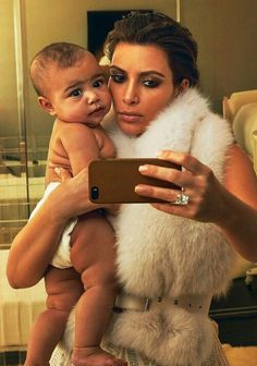 Kim kardashian and North West. Kim K just needs to start smiling in her pics. #TrueFact