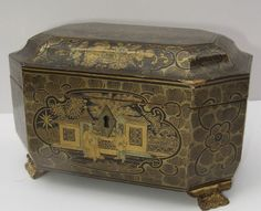 Chinese Export Lacquered Tea Caddy. Carved feet, diamond shape escutcheon Circa 1820