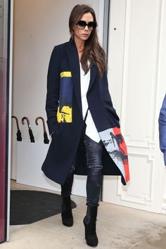 Arriving back on British soil after her New York Fashion Week triumph, Victoria Beckham paid a visit to her Dover Street store in another one of her SS16 creations. Wearing a long coat with a red, blue and yellow print, it effortlessly dressed up her casual ensemble. What. A. Pro.