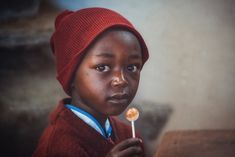 Cute Maasai student and his lollipop. Arusha, African Tribes, Cute Little Things, Black And White Portraits, Tanzania, Fine Art Photography, Student, Children, Young Children